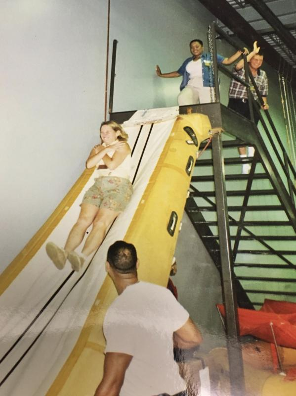 Gail on the escape slide - UPS Passenger Flights - AeroSavvy